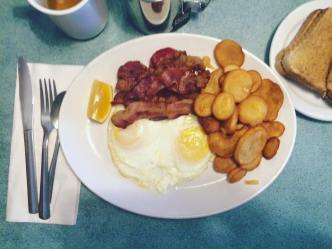 Two eggs and bacon with the most delicious homefries.