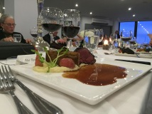 leek ash crusted venison with potato pave, parsnip puree, baby chioggia beets, demi glace paired with Stratus 2012 Red
